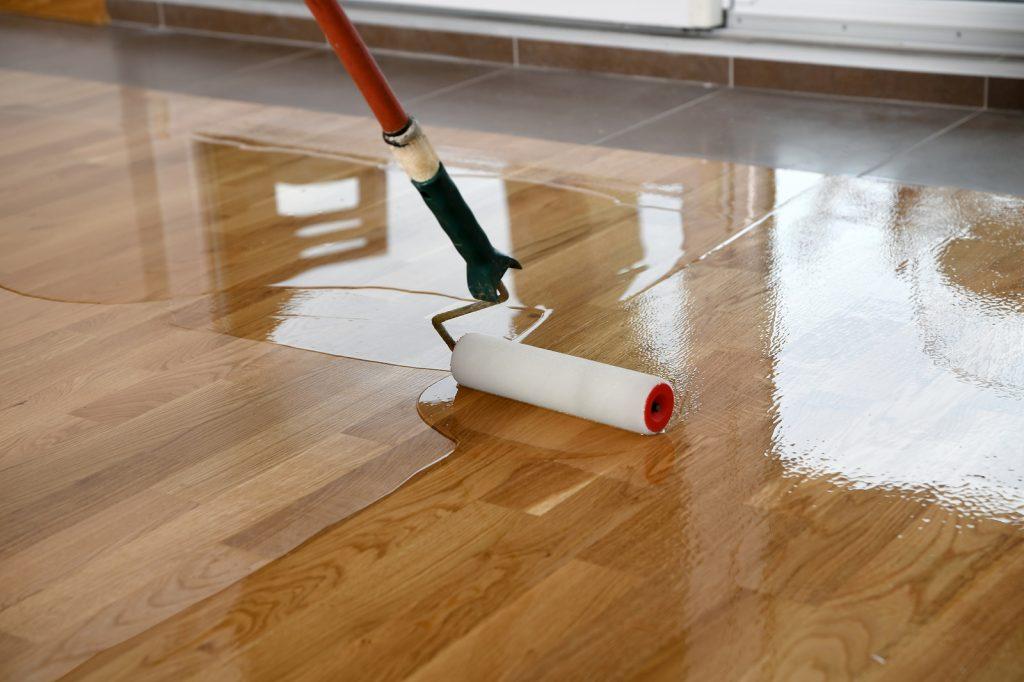 Hardwood timber floor being coated