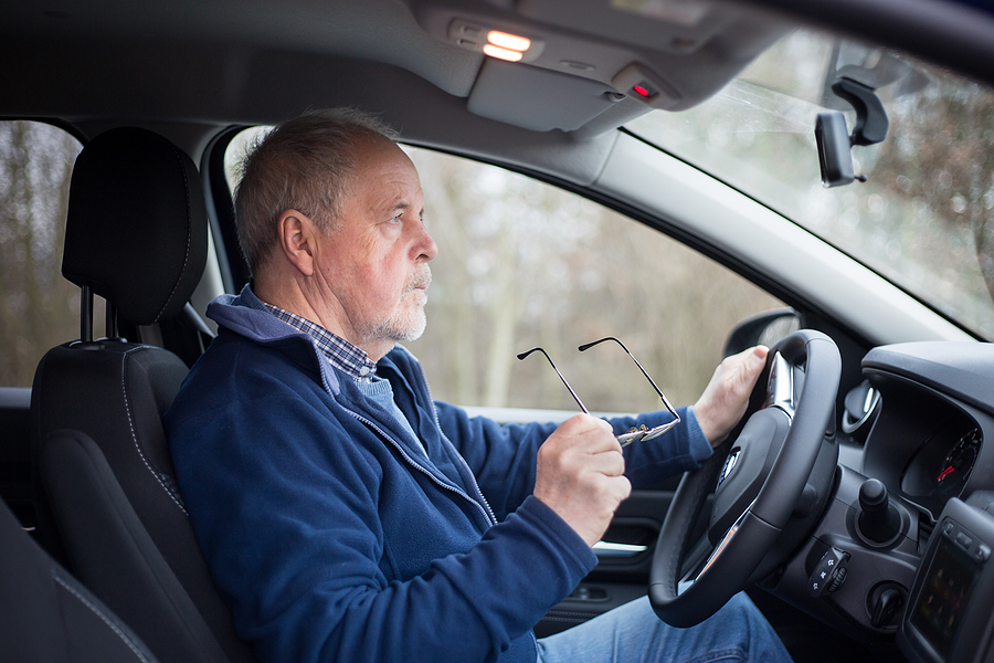 Old man taking a driving evaluation for seniors