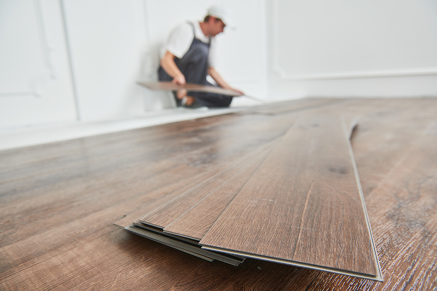 Worker laying hardwood flooring made in Melbourne